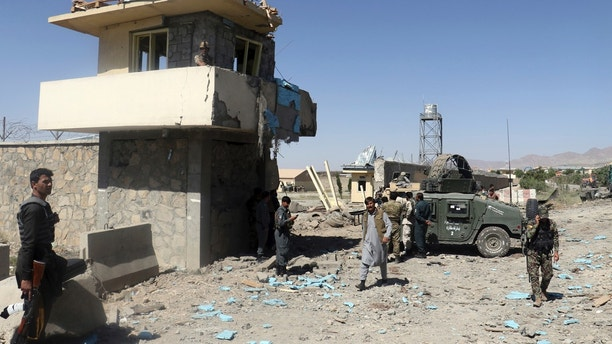 Security forces are deployed as the site of suicide attacks and an ongoing clash between Taliban insurgents and government forces in the main police station in eastern Paktia province, Afghanistan, Sunday, Jun 18, 2017. The Taliban stormed a police headquarters in eastern Afghanistan on Sunday after striking it with two suicide car bombs, killing several police officers, officials said. (AP Photos/Ihsanullah Mahjoor )