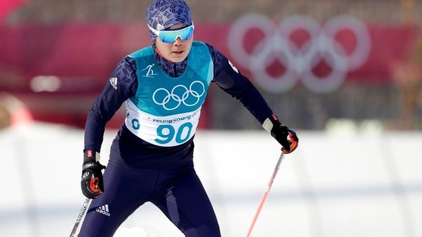 Yong Gum Ri, of North Korea, competes during the women's 10km freestyle cross-country skiing competition at the 2018 Winter Olympics in Pyeongchang, South Korea, Thursday, Feb. 15, 2018. (AP Photo/Dmitri Lovetsky)