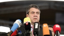 German foreign minister Sigmar Gabriel,  delivers a statements about the release of 'Die Welt' journalist  Deniz Yucel from prison, in Berlin, Germany, Friday, Feb. 16, 2018. The German reporter detained in Turkey for more than a year was released from jail pending trial, even as six other journalists and newspaper employees were sentenced to life imprisonment by a Turkish court Friday. (Kay Nietfeld/dpa via AP)