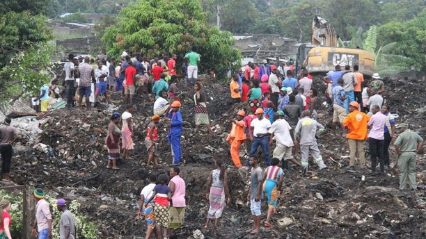 17 killed in garbage dump mudslide in Mozambique
