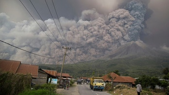 Mount Sinabung spews volcanic ash as it erupts in Kutarakyat, North Sumatra, Indonesia, Monday, Feb. 19, 2018. Rumbling Mount Sinabung on the Indonesian island of Sumatra has shot billowing columns of ash more than 5,000 meters (16,400 feet) into the atmosphere and hot clouds down its slopes. (AP Photo/Endro Rusharyanto)