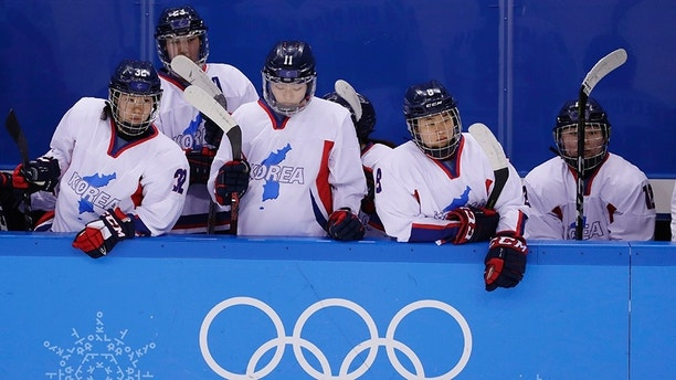 North Korea's Jin Ok (32), of the combined Koreas team, joins teammates Park Yoonjung (23), Park Ye-eun (11), Kim Selin (8), and Kim Heewon (12) during the third period of the classification round of the women's hockey game at the 2018 Winter Olympics in Gangneung, South Korea, Sunday, Feb. 18, 2018. Switzerland won 2-0. (AP Photo/Frank Franklin II)