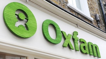 FILE: _ This is a May 21, 2015 file  photo of an Oxfam store in London. Oxfam's deputy chief executive on Monday Feb. 12, 2018 resigned amid the scandal involving sex abuse in Haiti after the 2010 earthquake. Penny Lawrence says she's ashamed of what happened on her watch. Development Secretary Penny Mordaunt is demanding that Oxfam show moral accountability and provide full disclosure about the case. She has threatened to pull public funding unless the charity reveals everything it knows about allegations.  (Nick Ansell/PA via AP, file)