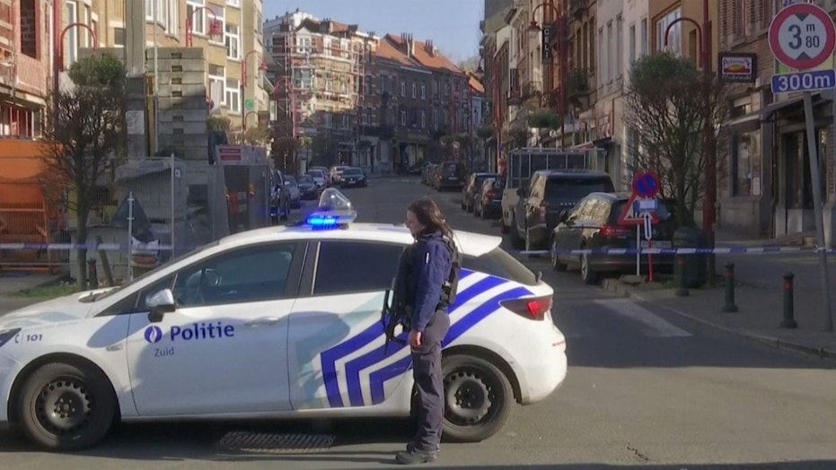 Belgian police have sealed off part of a Brussels suburb amid reports that an armed man could be at large.