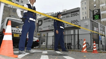Police officers stands guard near the site where around 380 million yen ($3.5 million) in cash was allegedly robbed from a man in Fukuoka, southwestern Japan, in this photo taken by Kyodo April 20, 2017.   Mandatory credit Kyodo/via REUTERS ATTENTION EDITORS - THIS IMAGE WAS PROVIDED BY A THIRD PARTY. EDITORIAL USE ONLY. MANDATORY CREDIT. JAPAN OUT. NO COMMERCIAL OR EDITORIAL SALES IN JAPAN. - RC1C55A19750