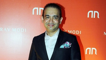 Indian jeweller Nirav Modi poses during the launch of his store in Mumbai, India, March 14, 2015. Picture taken March 14, 2015. Fotocorp/Handout via REUTERS  ATTENTION EDITORS - THIS IMAGE WAS PROVIDED BY A THIRD PARTY NO ARCHIVES NO RESALES - RC16E6111240