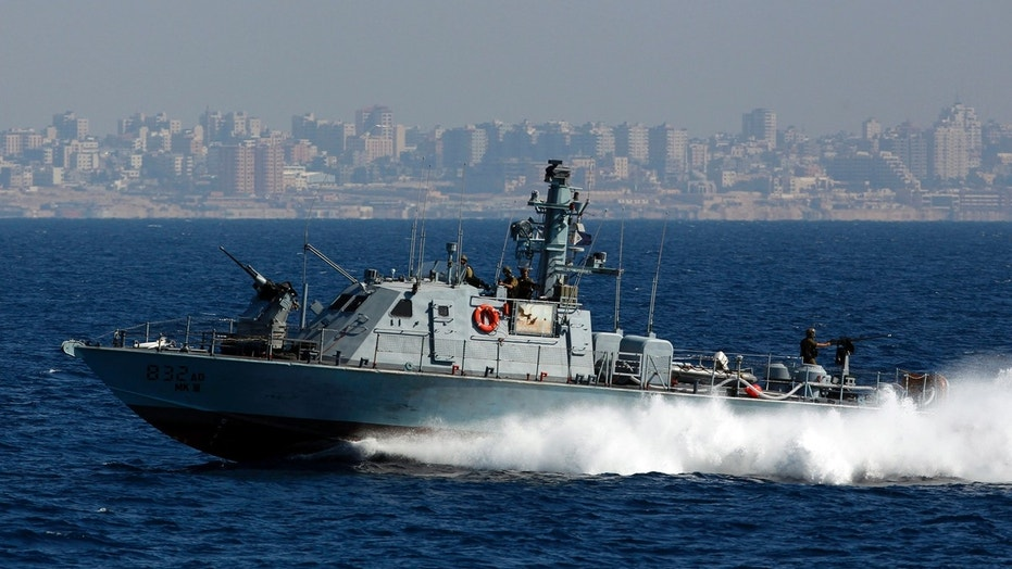 An Israeli Navy vessel patrols along the shores of the Gaza Strip in the Mediterranean Sea.