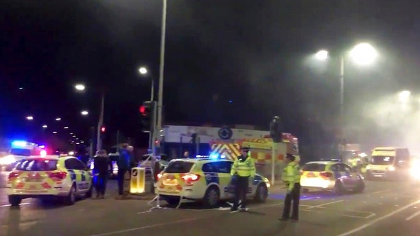 "In this image taken from video made available by Gem News, police attend the scene of an incident in Leicester, central England, Sunday Feb. 25, 2018. Police for the English city of Leicester say they are responding to a ""major incident"" after receiving reports of an explosion and that emergency services were dealing with the incident on Hinckley Road and asked the public to stay away from the area. (Gem News via AP)"