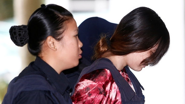 Vietnamese Doan Thi Huong, who is on trial for the killing of Kim Jong Nam, the estranged half-brother of North Korea's leader, is escorted as she arrives at the Shah Alam High Court on the outskirts of Kuala Lumpur, Malaysia January 22, 2018. REUTERS/Lai Seng Sin TPX IMAGES OF THE DAY - RC1A53254A10