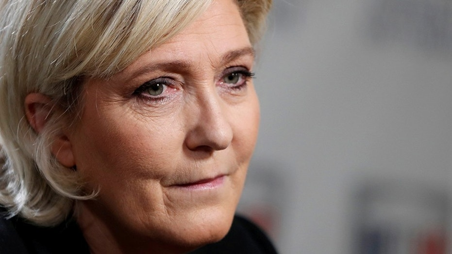 Marine Le Pen, France's far-right National Front (FN) political party leader, tweeted brutal images of Islamic State violence.