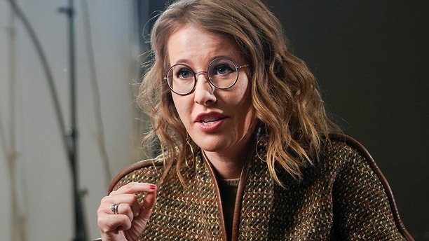 In this photo taken on Thursday, Feb. 1, 2018, Russian celebrity TV host Ksenia Sobchak, who wants to challenge Russian President Vladimir Putin in the March 18 presidential election, speaks during an interview to the Associated Press in Moscow, Russia. The daughter of Putin's patron in the 1990s, the late reformist mayor of St. Petersburg, she has assailed the Kremlin's policies but avoided personal criticism of Putin. (AP Photo/Alexander Zemlianichenko)