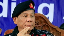 Philippine President Rodrigo Duterte, wearing a military uniform, gestures as he attends the 67th founding anniversary of the First Scout Ranger regiment in San Miguel town, Bulacan province, north of Manila, Philippines November 24, 2017.        REUTERS/Romeo Ranoco - RC17191BBD20