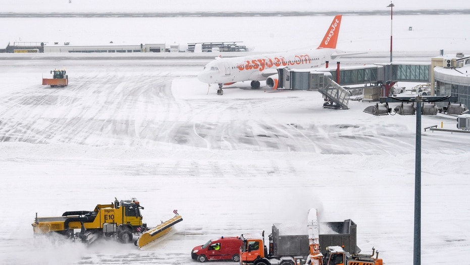 The fire brigade of Airport Security Services (SSA) rides snowplows removing snow on the runway during at the Geneva Airport, in Geneva, Switzerland, Thursday, March 1, 2018.