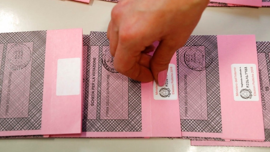 Polling station workers prepare ballots in Rozzano, near Milan, Italy, on Saturday.