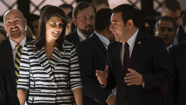 Nikki Haley, U.S. ambassador to the U.N., left, walks with Guatemala's President Jimmy Morales after their meeting at the National Palace of Culture in Guatemala City, Wednesday, Feb. 28, 2018.  (AP Photo/Luis Soto)
