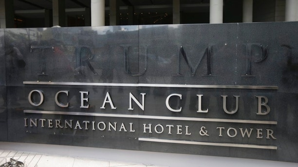 A marquee with the word Trump removed, is seen outside the Trump Ocean Club International Hotel and Tower in Panama City, Monday, March 5, 2018. Escorted by police officers and a Panamanian judicial official, the owner of the Trump Panama City hotel has taken control of the property. A team of Trump security officials left the property. (AP Photo/Arnulfo Franco)