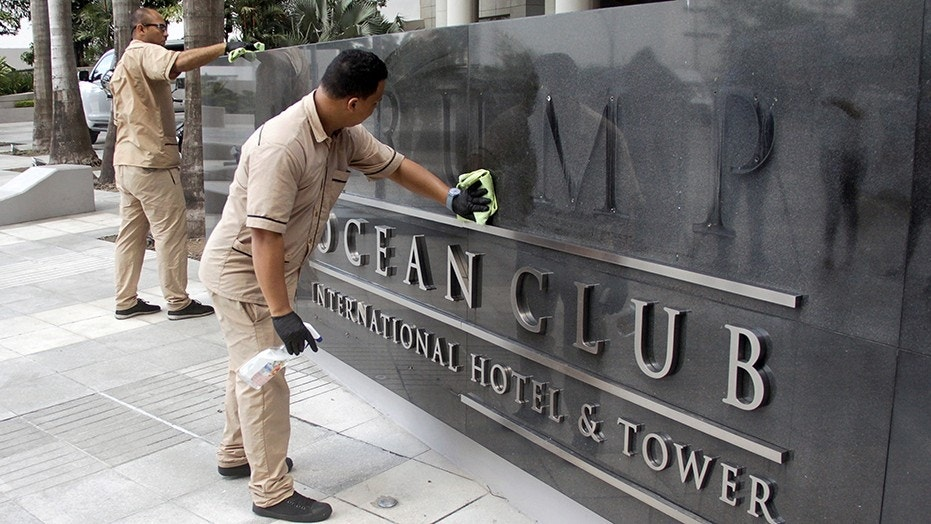 A worker cleans the site where the Trump name was removed from the Trump Ocean Club International Hotel and Tower in Panama City, Panama March 5, 2018.