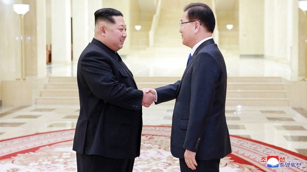 "In this Monday, March 5, 2018 photo, provided by the North Korean government on March 6, North Korean leader Kim Jong Un, left, shakes hands with South Korean National Security Director Chung Eui-yong in Pyongyang, North Korea. Independent journalists were not given access to cover the event depicted in this image distributed by the North Korean government. The content of this image is as provided and cannot be independently verified. Korean language watermark on image as provided by source reads: ""KCNA"" which is the abbreviation for Korean Central News Agency. (Korean Central News Agency/Korea News Service via AP)"