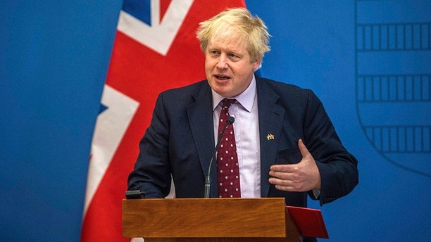 British Foreign Secretary Boris Johnson speaks during his joint press conference with Hungarian Minister of Foreign Affairs and Trade Peter Szijjarto following their talks in Budapest, Hungary, Friday, March 2, 2018. (Zoltan Balogh/MTI via AP)