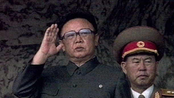 North Korean leader Kim Jong-il salutes during a ceremony commemorating North Korea's 50th anniversary of the founding of the state in Pyongyang September 9. North Korea celebrated its 50th anniversary with a grand military parade featuring banners hailing long life for the country's late founder, Kim Il-sung.