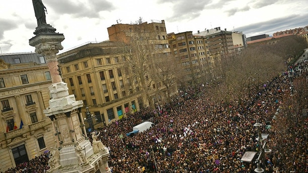 Thousands of demonstrators protest male violence against women and demanding an equality labour opportunities at  the Paseo Sarasate Promenade, during the female general strike to commemorate International Women's Day, in Pamplona, northern Spain, Thursday, March 8, 2018. (AP Photo/Alvaro Barrientos)