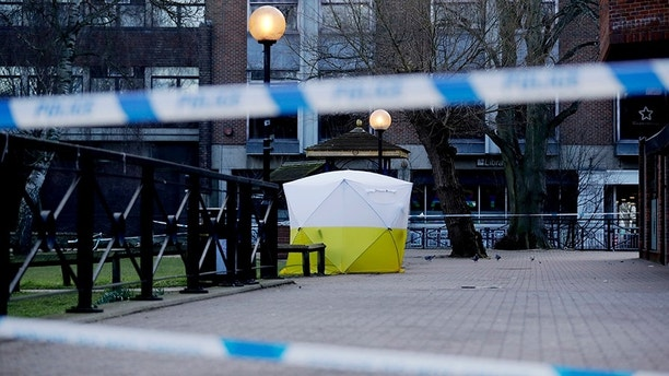 """A police tent is framed by police tape covering the the spot where former Russian double agent Sergei Skripal and his daughter were found critically ill Sunday following exposure to an """"unknown substance"""" in Salisbury, England, Wednesday, March 7, 2018. Britain's counterterrorism police took over an investigation Tuesday into the mysterious collapse of the former spy and his daughter, now fighting for their lives. The government pledged a """"robust"""" response if suspicions of Russian state involvement are proven. Sergei Skripal and his daughter are in a critical condition after collapsing in the English city of Salisbury on Sunday. (AP Photo/Matt Dunham)"""