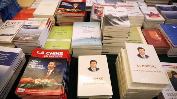 Magazines and books, featuring Chinese President Xi Jinping on the cover, are seen at the media centre during the China's National People's Congress (NPC) in Beijing, China March 7, 2018. REUTERS/Aly Song NO RESALES. NO ARCHIVES. - RC16F9D74580