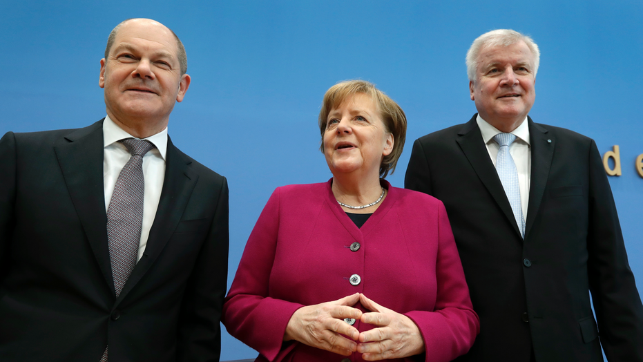 Merkel elected for a fourth term, set to head crumbling coalition