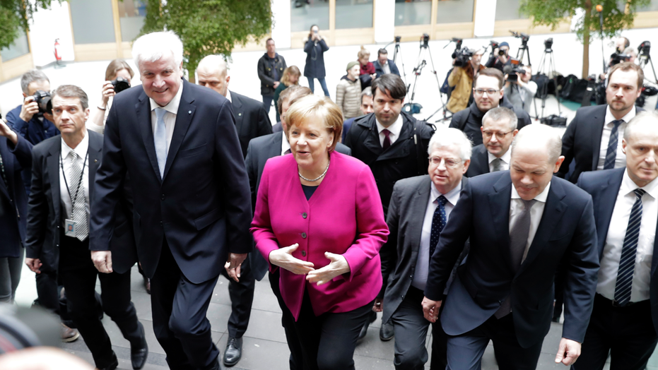 German chancellor confronted with pleas for help