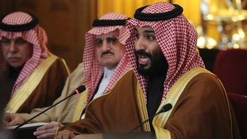 Saudi Crown Prince Mohammed bin Salman conducts a meeting with Britain's Prime Minister Theresa May with other members of their delegations, inside 10 Downing Street, London, on Wednesday March 7, 2018. Saudi Arabia's Crown Prince Mohammed bin Salman received a royal welcome with high level political talks to begin his three day visit to Britain, although  protesters criticised the visit. (Dan Kitwood/Pool via AP)