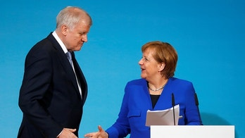 Acting German Chancellor Angela Merkel and leader of the Christian Social Union in Bavaria (CSU) Horst Seehofer shake hands during a news conference after exploratory talks about forming a new coalition government at the SPD headquarters in Berlin, Germany, January 12, 2018.  REUTERS/Hannibal Hanschke - RC1AC1D0C500
