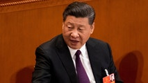 Chinese President Xi Jinping talks to leaders after being formally re-elected to a second term as China's President during a plenary session of China's National People's Congress at the Great Hall of the People in Beijing, Saturday, March 17, 2018. Xi was reappointed Saturday as China's president with no limit on the number of terms he can serve. The ceremonial National People's Congress voted unanimously for Xi's second five-year term as president. (AP Photo/Andy Wong)