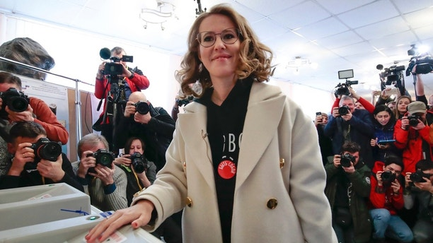 Russian Presidential candidate Ksenia Sobchak casts her ballot for the Russian presidential election, in Moscow, Russia, Sunday, March 18, 2018. Russians are voting in a presidential election in which Vladimir Putin is seeking a fourth term in the Kremlin. [AP Photo/Denis Tyrin)
