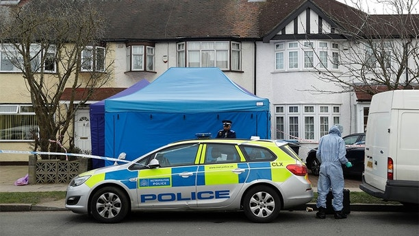 FILE - In this Wednesday, March 14, 2018 file photo, police work at the scene outside a house in New Malden, south west London, which has been sealed-off after Russian businessman Nikolai Glushkov was found dead. British police say on Friday, March 16, 2018 they are treating the death of London-based Russian businessman Nikolai Glushkov as a homicide, after a post-mortem revealed he died from compression to the neck. Glushkov was an associate of Boris Berezovsky, a Russian oligarch and Kremlin critic who died under disputed circumstances in 2013. (AP Photo/Matt Dunham, file)