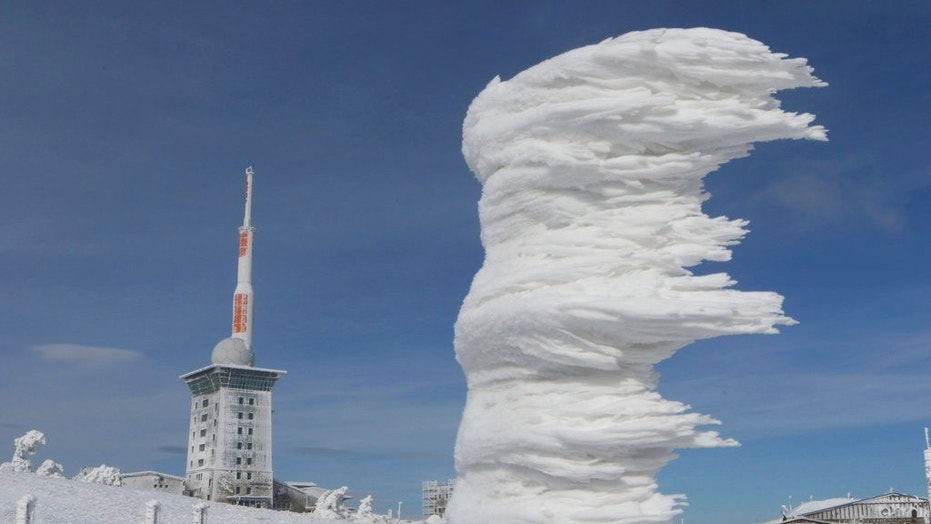 Wind and white frost have formed an ice sculpture on Brocken mountain in the Harz region, Germany, Sunday, March 18, 2018.