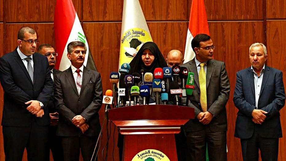 Najiha Abdul-Amir al-Shimari, center, the head of Iraq's Martyrs Establishment speaks during a press conference, in Baghdad, Iraq, Tuesday, March 20, 2018. Al-Shimari said Tuesday, that the bodies of 38 of the 39 Indians abducted by the Islamic State group in 2014 were found in a mass grave outside Mosul.