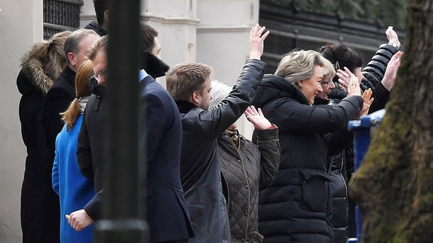 Embassy staff wave as colleagues and children board buses outside Russia's Embassy in London, Britain, March 20, 2018. REUTERS/Toby Melville - RC1326475740