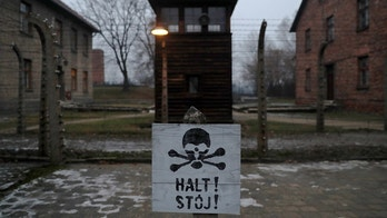 "A sign reading ""Stop!"" in German and Polish is seen at the former Nazi German concentration and extermination camp Auschwitz, during the ceremonies marking the 73rd anniversary of the liberation of the camp and International Holocaust Victims Remembrance Day, in Oswiecim, Poland, January 27, 2018. REUTERS/Kacper Pempel     TPX IMAGES OF THE DAY - RC19C35BBE20"
