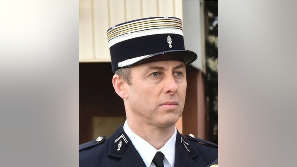 This image posted on Saturday, March 24, 2018 by the Gendarmerie Nationale on it's Facebook account shows a portrait of Lieutenant Colonel Arnaud Beltrame. A French police officer who offered himself up to an extremist gunman in exchange for a hostage has died of his injuries, the interior minister said Saturday. (Gendarmerie Nationale via AP)