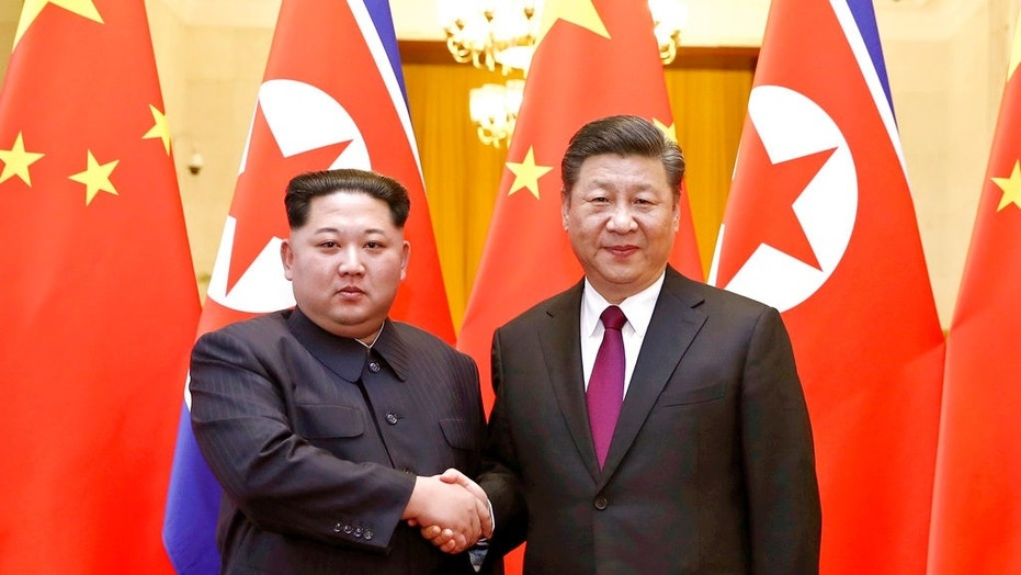 The Chinese government confirmed Wednesday that North Korea's leader Kim Jong Un, left, went to Beijing and met with Chinese President Xi Jinping, in Mr. Kim's first known trip to a foreign country since assuming power in 2011.