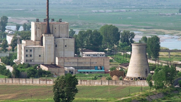 A North Korean nuclear plant is seen before demolishing a cooling tower (R) in Yongbyon, in this photo taken June 27, 2008 and released by Kyodo. North Korea is to restart the mothballed Yongbyon nuclear reactor that has been closed since 2007 in a move that could produce more plutonium for nuclear weapons as well as for domestic electricity production, its KCNA news agency said on April 2, 2013. As well as restarting the 5MW reactor at Yongbyon, the North's only known source of plutonium for its nuclear weapons programme, KCNA said a uranium enrichment plant would also be put back into operation, a move that could give it a second path to the bomb. Picture taken June 27, 2008. Mandatory Credit. REUTERS/Kyodo (NORTH KOREA - Tags: ENERGY POLITICS TPX IMAGES OF THE DAY) FOR EDITORIAL USE ONLY. NOT FOR SALE FOR MARKETING OR ADVERTISING CAMPAIGNS. MANDATORY CREDIT. JAPAN OUT. NO COMMERCIAL OR EDITORIAL SALES IN JAPAN. ATTENTION EDITORS - THIS IMAGE WAS PROVIDED BY A THIRD PARTY. THIS PICTURE IS DISTRIBUTED EXACTLY AS RECEIVED BY REUTERS, AS A SERVICE TO CLIENTS - GM1E9421A7601