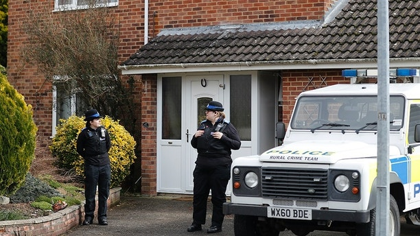 FILE - In this Tuesday, March 6, 2018 file photo, police officers stand outside the house of former Russian double agent Sergei Skripal in Salisbury, England. British police say they believe a Russian ex-spy and his daughter first came into contact with a military-grade nerve agent at their front door. Deputy Assistant Commissioner Dean Haydon says in a statement Wednesday, March 28 police are now focusing their investigation in and around Sergei Skripal's home. (AP Photo/Frank Augstein, file)