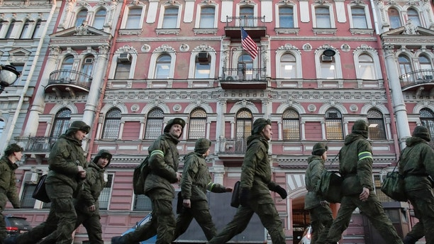 Military cadets walk past the U.S. consulate in St.Petersburg, Russia, Saturday, March 31, 2018. Russia announced the expulsion of more than 150 diplomats, including 60 Americans, on Thursday and said it was closing a U.S. consulate in retaliation for the wave of Western expulsions of Russian diplomats over the poisoning of an ex-spy and his daughter in Britain, a tit-for-tat response that intensified the Kremlin's rupture with the United States and Europe. (AP Photo/Dmitri Lovetsky)