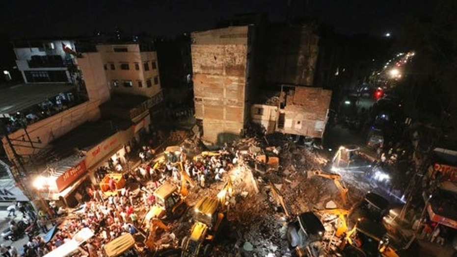 Rescuers working in the debris Saturday after a three-story rickety hotel building collapsed in Indore, Madhya Pradesh state, India.