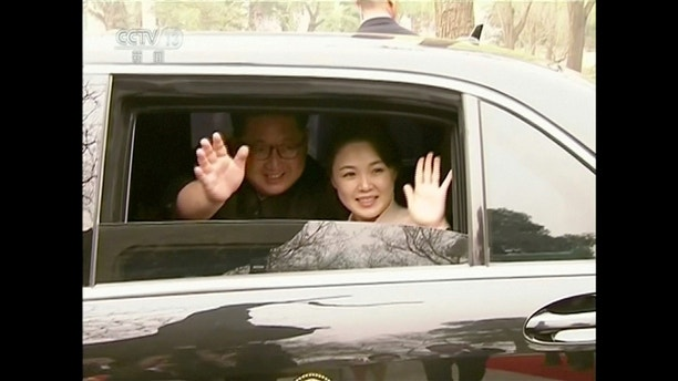 North Korean leader Kim Jong Un and his wife Ri Sol Ju wave and smile in Beijing, in this still image taken from video released on March 28, 2018. North Korean leader Kim Jong Un visited China from Sunday to Wednesday on an unofficial visit, China's state news agency Xinhua reported on Wednesday. CCTV via Reuters TV ATTENTION EDITORS -  NO RESALES. NO ARCHIVES. CHINA OUT. - RC167C2EF360