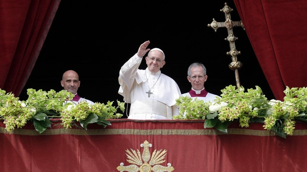 Pope Francis delivers the Urbi et Orbi (to the city and to the world) blessing at the end of the Easter Sunday Mass in St. Peter's Square at the Vatican, Sunday, April 1, 2018. (AP Photo/Andrew Medichini)