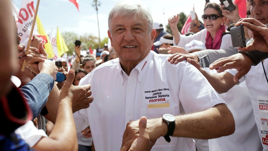 April 1: Leftist front-runner Andres Manuel Lopez Obrador greets supporters during his campaign rally in Ciudad Juarez.