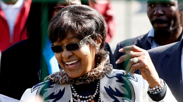 Winnie Madikizela-Mandela greets wellwishers gathered to wish to former President Nelson Mandela happy birthday outside the hospital where he is being treated in Pretoria, July 18, 2013. The ailing Mandela turns 95 today.  REUTERS/Mike Hutchings (SOUTH AFRICA - Tags: POLITICS HEALTH) - GM1E97I1J7F01