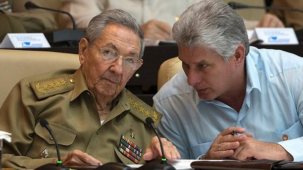 Cuba's President Raul Castro (L) chats with Cuba's Vice President Miguel Diaz-Canel react during the National Assembly in Havana, Cuba, July 8, 2016. Ismael Francisco/Courtesy of Cubadebate/Handout via Reuters. ATTENTION EDITORS - THIS PICTURE WAS PROVIDED BY A THIRD PARTY. FOR EDITORIAL USE ONLY. - S1BETONHQPAA