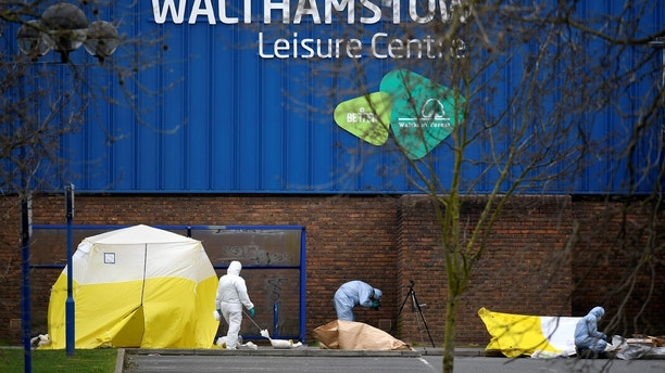 Forensic investigators examine the scene around Walthamstow Leisure Centre, where a teenage boy was shot, in London, Britain, April 3, 2018. REUTERS/Toby Melville - RC14CBA530F0